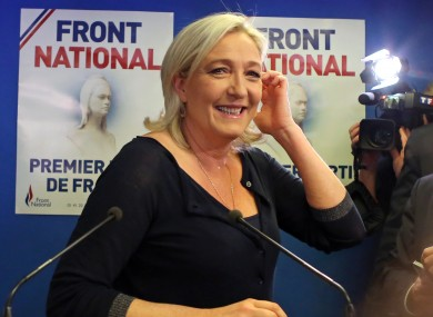 Far right party National Front leader Marine Le Pen poses for photographers before addressing reporters at the party's headquarters in Nanterre, west of Paris, today.
