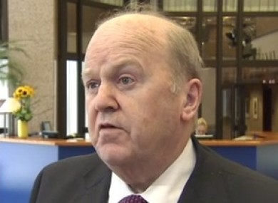 Michael Noonan speaking to reporters in Brussels yesterday.