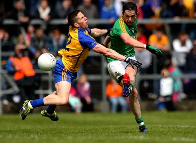 Darren Sweeney gets a show away despite the attention of Seanie McDermott.
