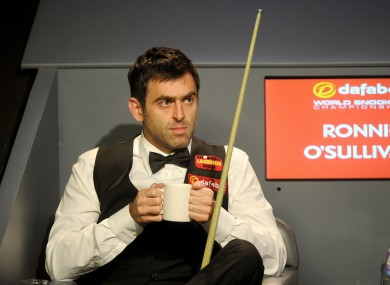 Ronnie O'Sullivan enjoys a cup of tea during his match against Barry Hawkins.