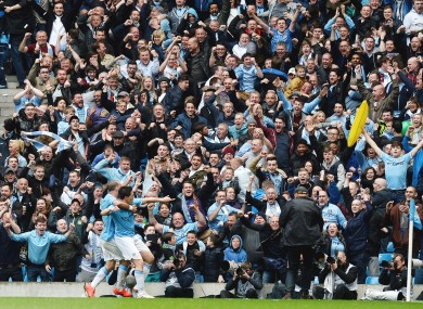 Manchester City's Samir Nasri (centre) celebtrates after scoring his side's first goal of the game.