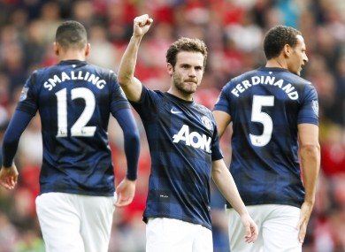 Manchester United's Juan Mata celebrates his goal from a free kick.