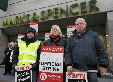 File: Derek Chervi, Helen Carey and Pat Hayden, at the Marks and Spencer's store on Mary Street in Dublin strike last December.
