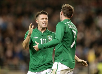 Keane celebrates with Aiden McGeady during his most recent international appearance, against Latvia.