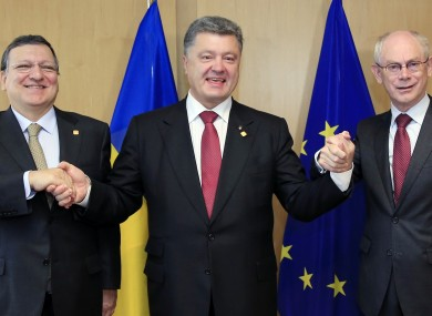Ukraine's President Petro Poroshenko, center, poses with European Commission President Jose Manuel Barroso, left, and European Council President Herman Van Rompuy.