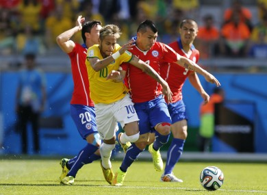 Chile's Gary Medel brushes Neymar off the ball.