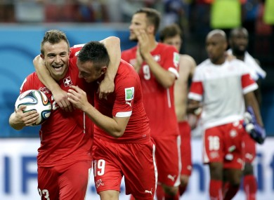 Shaqiri carries off the match ball while embracing Drmić.