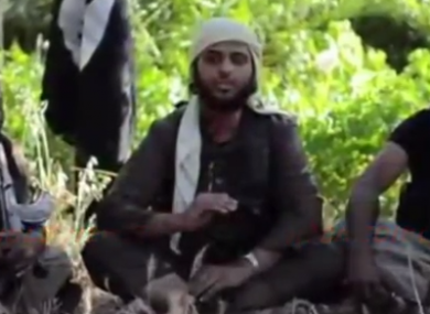 A screengrab from the video shows Nasser Mathuna (centre).
