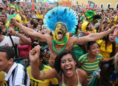 Brazilian supporters shows their delight at the penalty victory over Chile.
