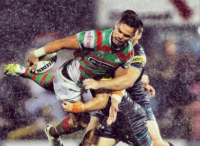 Ben Te'o ships a tackle as he tries to offload.