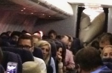 Plane's evacuation slide accidentally inflates in mid-flight… inside the cabin