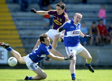 Wexford's Ciaran Lyng with Padraig McMahon and Peter O'Leary of Laois.