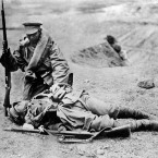 A Japanese soldier attempts in vain to rouse his dead comrade.<span class=