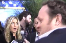 Super tall reporter scares the bejaysus out of Jen Aniston and Adam Sandler