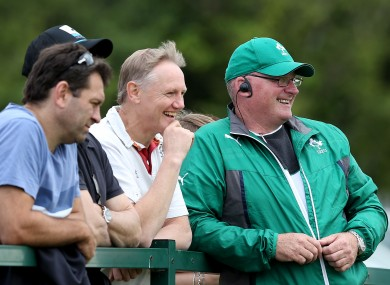 Les Kiss (black cap), Joe Schmidt and Philip Doyle watch Ireland versus Wales at Malahide RFC.