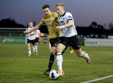 Dundalk's John Mountney and Shamrock Rovers midfielder Ronan Finn.