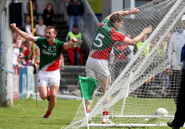 Lee Keegan hits the back of the net after scoring a goal as Cillian O'Connor celebrates setting him up