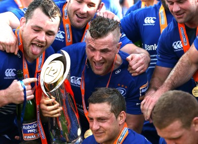Leinster players pose with the Pro12 trophy at the end of last season.