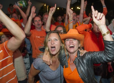 People celebrate as they watch the Dutch team win after penalties in the World Cup quarter-finals.
