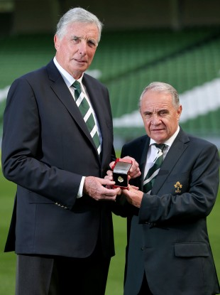 Outgoing President Pat Fitzgerald [R] with the IRFU's new man, Louis Magee.