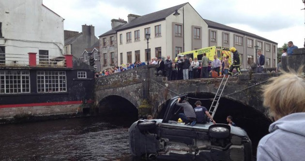 Couple in their 80s hospitalised after car crashes into river
