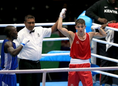 Michael Conlan celebrates winning his match against Uganda's Bashir Nasir.
