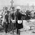 A trumpet player in a funeral for an American casualty in the Argonne in November 1918.<span class=