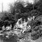 Convalescencing soldiers admire a waterfall in the grounds of Longleat House.<span class=