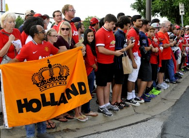 United fans in Maryland wait for the players and their new boss earlier t