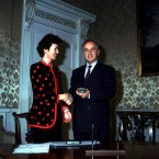 Former Irish President Mary Robinson giving Reynolds his seal of office in 1993.
