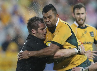 Australia's Kurtley Beale collides with Richie McCaw in Sydney.