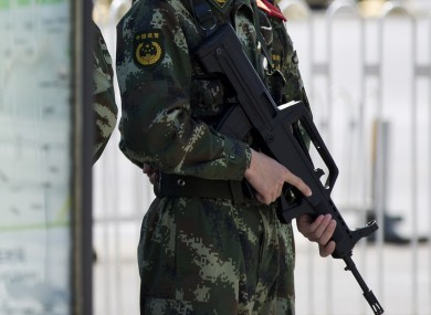 File photo of an armed Chinese police officer.