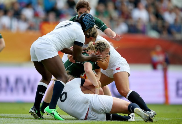 Niamh Briggs tackled by Alex Matthews and Margret Alphons