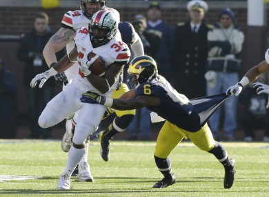 Ohio State running back Carlos Hyde (34) is tackled by Michigan defensive back Raymon Taylor.
