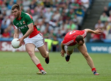 Seamus O'Shea leaves Cork's Brian O'Driscoll in his wake.