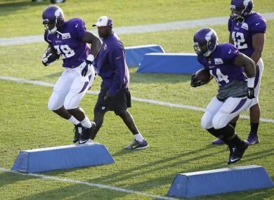 Minnesota Vikings running backs Adrian Peterson and Matt Asiata work out.