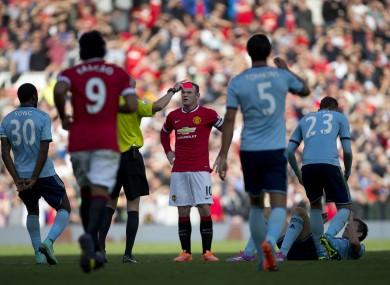 Wayne Rooney receives his marching orders.