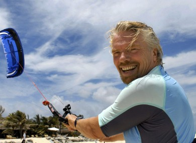 Richard Branson takes his holidays on Necker Island, so he probably will be taking advantage of his policy.