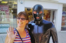 A man dressed as a gimp is wandering around Essex, taking selfies with locals