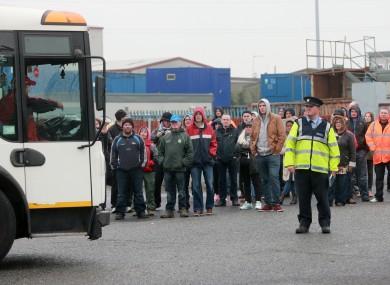 Gardai redirect Greyhound trucks blocked by supporters of the striking workers.