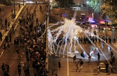 Hong Kong protesters stay on streets despite tear gas and riot police