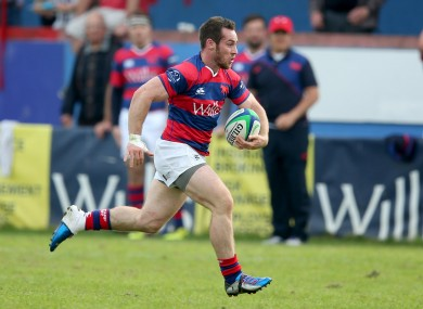 Rob McGrath sprints home for a Clontarf try against Young Munster.