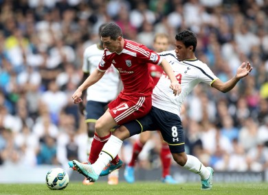 Tottenham Hotspur's Paulinho (right) and West Browmich Albion's Graham Dorrans battle for the ball during during the Barclays Premier League match at White Hart Lane.