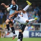 Bury's Tom Soars get stuck between a pair of Wycombe Wanderers. <span class=
