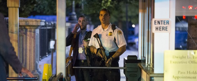 A Secret Service officer holds a gun near an entrance to the White House during the evacuation last night.