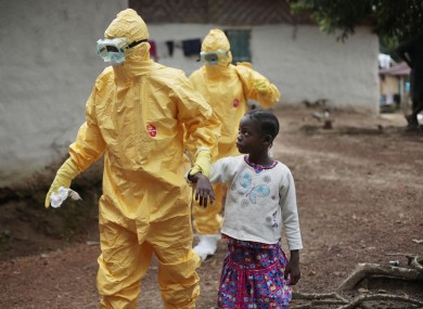 Nowa Paye, 9, is taken to an ambulance after showing signs of the Ebola infection in the village of Freeman Reserve.