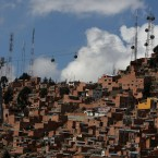A cable car between La Paz and El Alto passes through a neighbourhood in La Paz Bolivia. The system is the world''s highest cable car system, and transports thousands of passengers, about 4,000 metres above sea level. Bolivia will hold general elections on Sunday. (AP Photo/Martin Mejia)<span class=