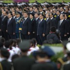 Chinese President Xi Jinping, centre left, Premier Li Keqiang, centre right, and high profile officials stand near the Monument to the People's Heroes during a ceremony marking Martyrs' Day at Tiananmen Square in Beijing, China.<span class=