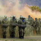 Colombian Army Special Forces soldiers run in a show of military exercises at the Tolemaida military base during a visit by U.S. Defense Secretary Chuck Hagel, in Melgar, Colombia.<span class=