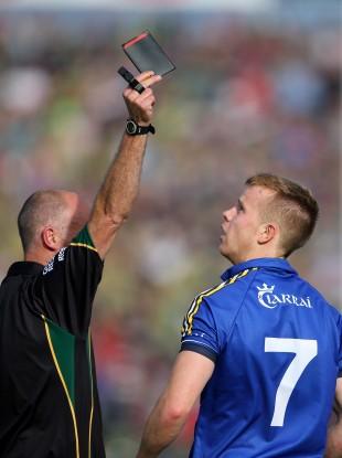 Cormac Reilly shows Fionn Fitzgerald a black card.